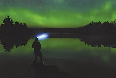 Posing for a self portrait under the Northern Lights on Two Island Lake.