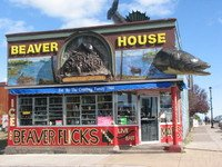 The Beaver House in Grand Marais, famed for its wonderful walleye sculpture, is closing its doors. The walleye is being sold with the building. Photo by Joan Farnam