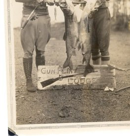 In this photo from the 1920s or '30s, Justine Kerfoot and a friend held a catch of huge lake trout.