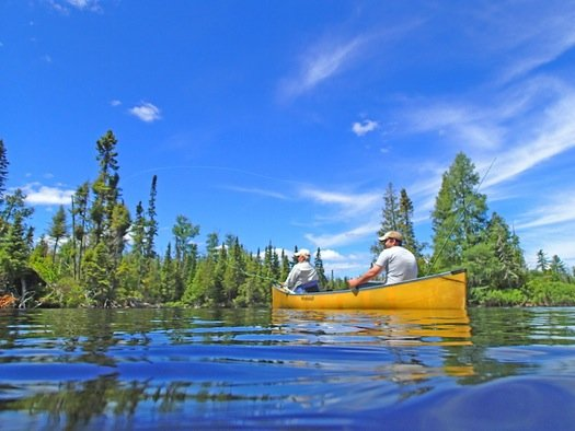 On a lake just off the Gunflint Trail in northeastern Minnesota, Bob Nasby of St. Paul cast a fly, while Joe Friedrichs awaited a smallmouth bass strike.