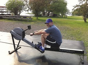 The intrepid author demonstrates his sculling technique on a stationary rowing machine, which is the starting point for learning how to row. | ERIC CHANDLER