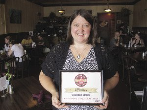Owner Sara Hingos holds the Crooked Spoon's award for Best Artistic Flare from the Chef.