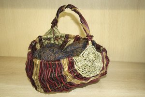 A dogwood basket woven with smoked deer hide and Siberian Iris cordage, made by the author. | Julia Prinselaar