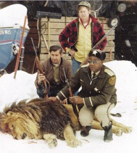 Dick Dorr (standing) , State Patrol officer Jim Dols and Sherrif John Lyght were forced to shoot an escaped lion in Lutsen. | Submitted