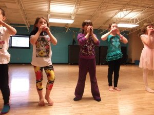 The 1st-3rd graders rehearse their dance in the YMCA studio. | Breana Roy