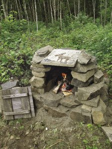 Everything tastes better when cooked outdoors on a stone oven.   KATHY TOIVONEN