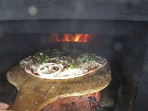 Pizza can take anywhere from 2 to 10 minutes to cook, depending on many factors.   KATHY TOIVONEN