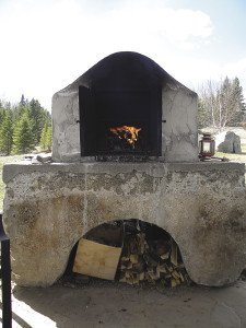 Outdoor brick ovens can hold a fire for days.   KATHY TOIVONEN