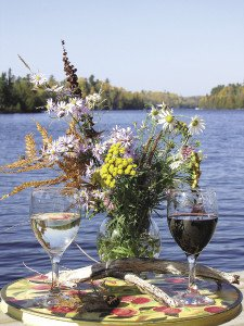 Enjoy a view of the lake while sipping a glass of wine. | THE DANCING BEAR CAFÉ