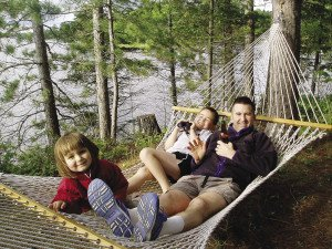 Grace, Sam, and Eric relaxing.   SHELLEY CHANDLER