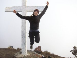 The author celebrates after reaching the top of Volcan Baru.