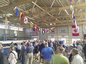 The crowd celebrates after the dedication of the new Joseph M. Krmpotich Boathouse. | ERIC CHANDLER