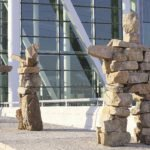 These three whimsical Inuksuit made of stacked orange granite stones greet passengers at the departure entrance at Terminal 1 of Toronto's Pearson International Airport.