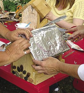 At Willow Springs Creative Centre, activities such as making rustic birdfeeders for a Christmas in July party occur. | SUBMITTED