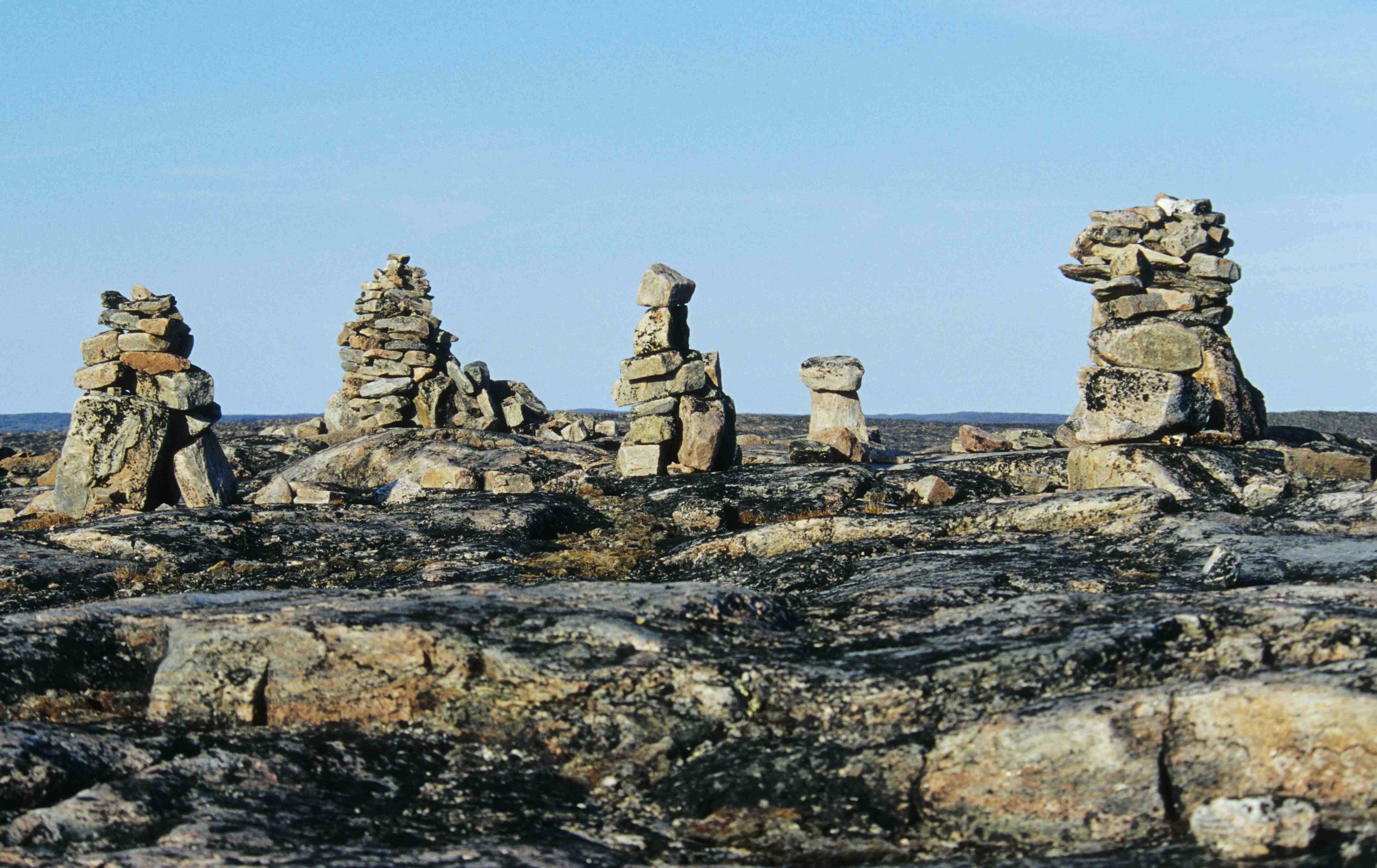 The approximately 100 Inuksuit still standing at Foxe Point, Baffin Island, were constructed as far back as 2,000 years ago. Credit Ansgar Walk.