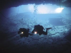 Divers brave frigid, dark waters to explore a shipwreck. | RYAN HAMLIN