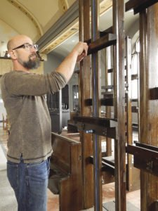 Artist and academy owner, Jeffrey T. Larson showing easels made from church pews. | KELSEY ROSETH