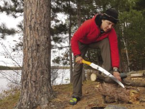 When living in the Boundary Waters, everyday chores included chopping and hauling wood.