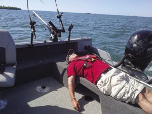 Author Gord Ellis grabs a little shut eye on a boat. | GORD ELLIS