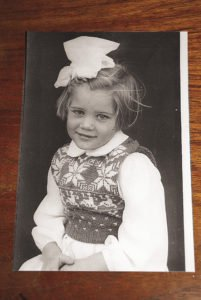 A photo of four-year-old Elle in Lowestoft,  England, dressed in a white, Christmas snowflake sweater knitted by her mom.  | ELLE ANDRA-WARNER