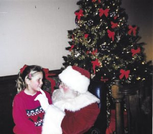 Casey Fitchett sits on Santa's lap. | CASEY FITCHETT