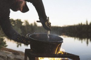 Cooking a boundary waters meal. | ZACH & ALLIE LEON
