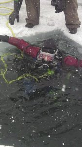 A diver braves the cold and ice.
