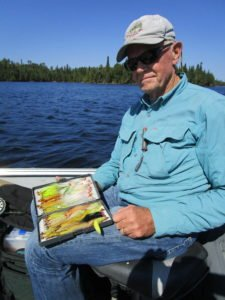 Dan Johnson of Oakdale shows a few of the flies he brought to the Nipigon country. | SHAWN PERICH