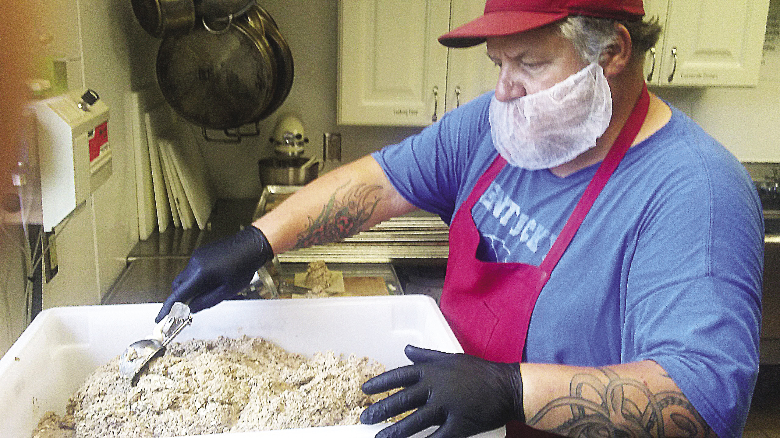 Shane Dickey of Superior Small Batch prepares vegan food at the community center in Finland. | SUBMITTED