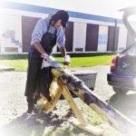 Garrick Waswa, age 16, scraping a deer hide. | MELISSA ROBERTS