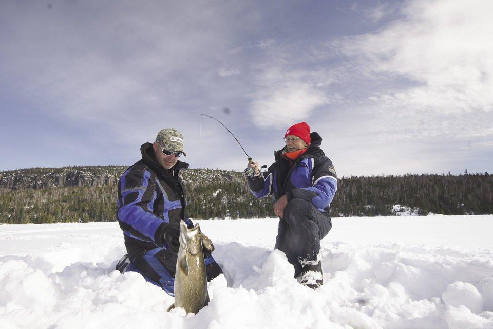 Tom Armstrong and Gord Ellis Senior with lake trout.   GORD ELLIS