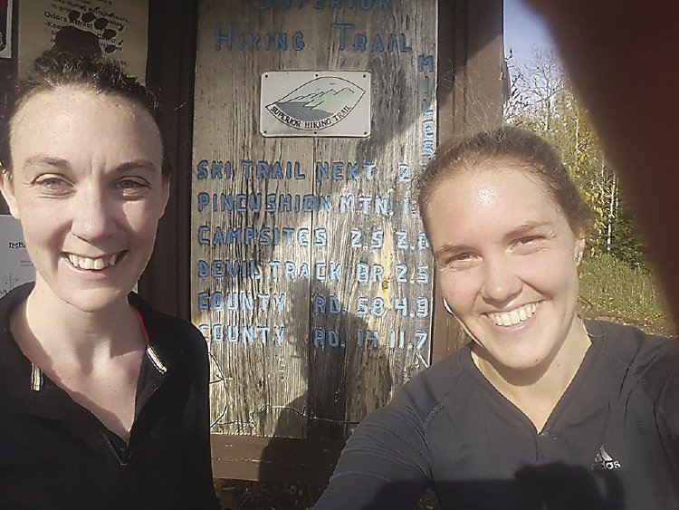Casey and best friend Marybeth are all smiles after a 13.1-mile fall run on the Superior Hiking Trail.