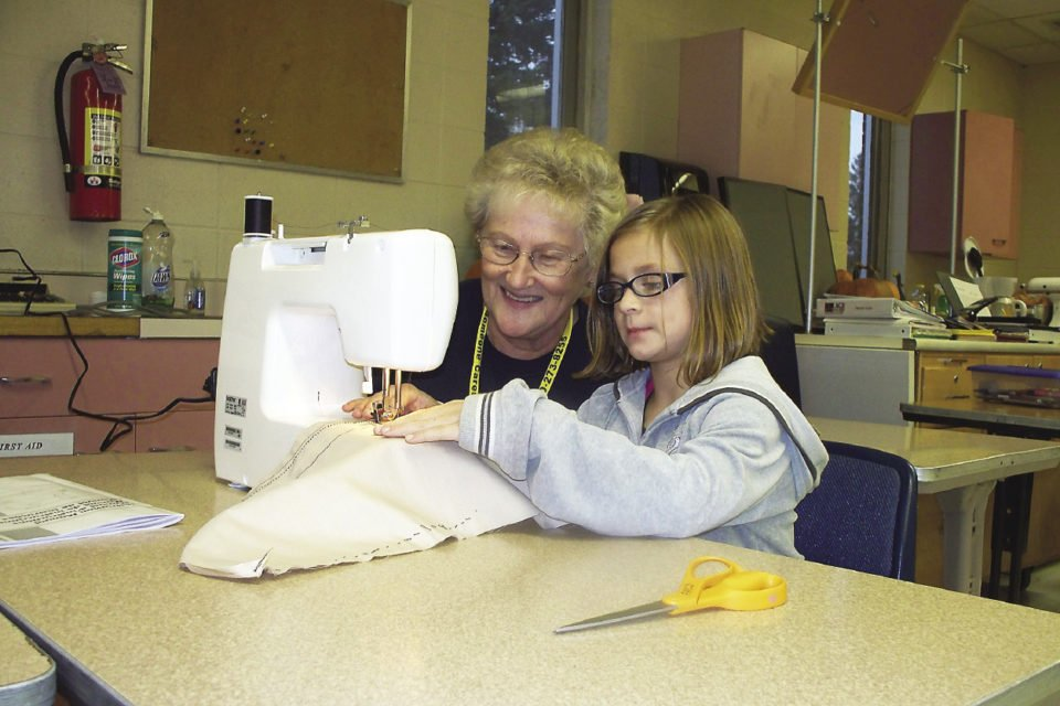 Many AGE to age sites undertake projects with older adults teaching kids various skills, such as sewing.