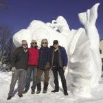 Snow sculpting teams submit a design and work together to sculpt their blocks of snow.