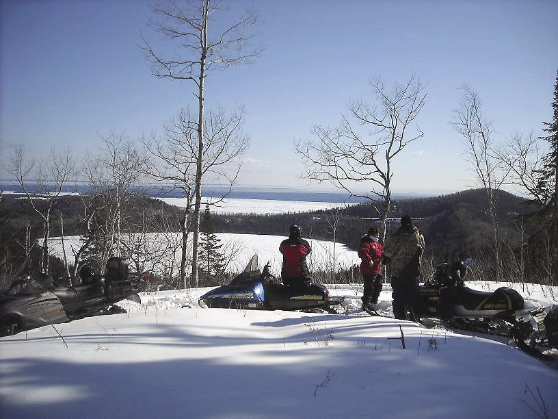 Snowmobilers on the Grand Portage trail overlooking Teal Lake.