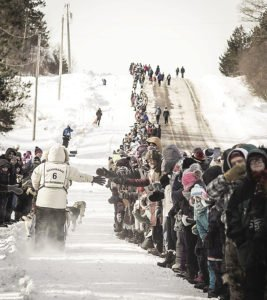 Crowds braving the weather lined the road at the Duluth race start.
