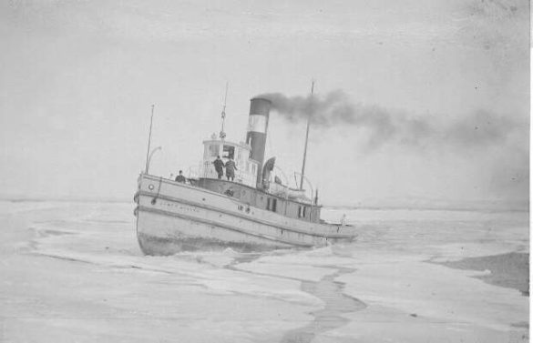 Taken sometime before 1922, three people stand aboard the James Whalen tug as it cuts through the ice in the Thunder Bay harbour. | PUBLIC DOMAIN