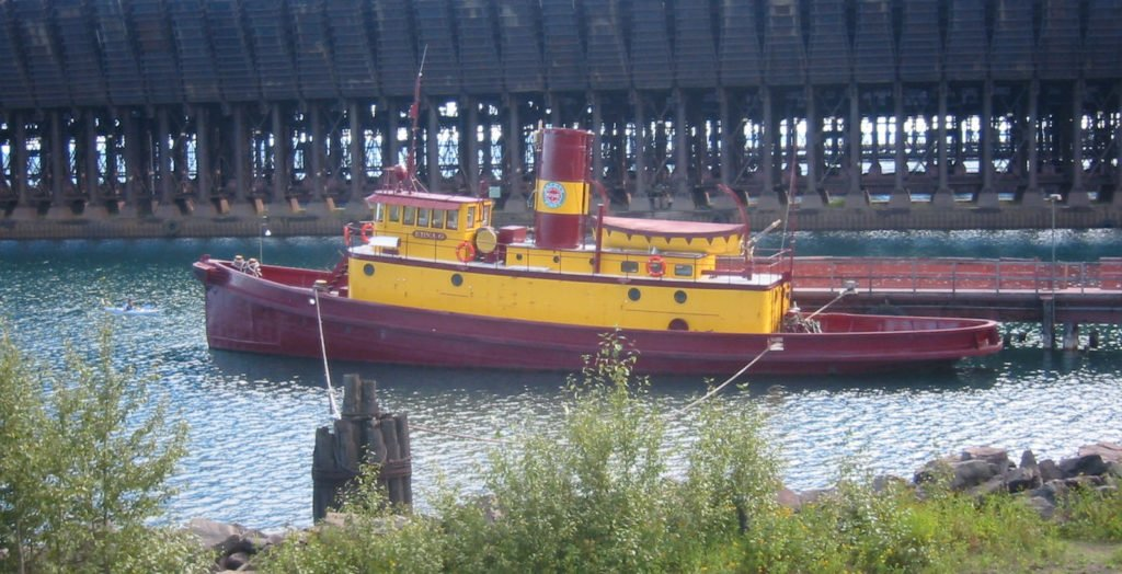 The retired Edna G, seen here moored at Two Harbors, was the last steam-powered coal-burning tugboat on the Great Lakes. ELKMAN