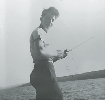 A young Ray Dupuis Sr. fishing.