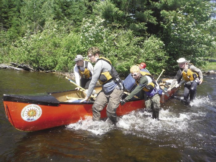Multiple portages, black flies, and wet weather are all part of the Outers Program, as are teamwork and cooperation in each brigade.