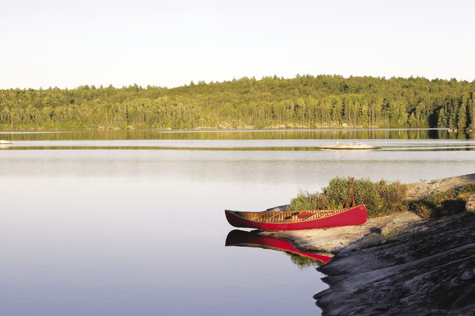 A canoe beached on a perfect sloping rock in the Northern Wilds.