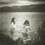 Mary Magicskin's daughters just coming out of a ceremonial sweat in front of Lake Superior.