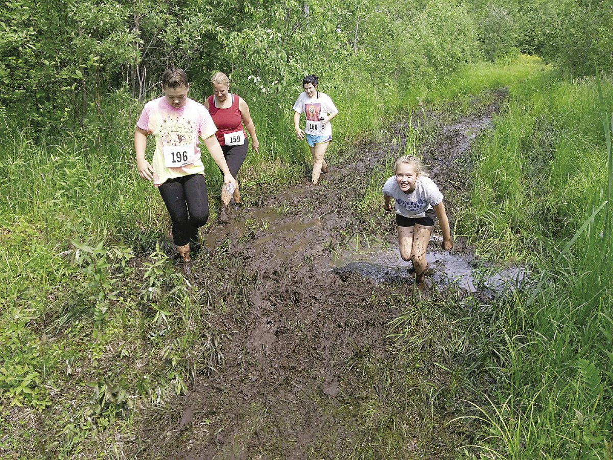 These walkers are following race founder Jan Horak's advice: stay to the side of the mudholes. | RHONDA SILENCE