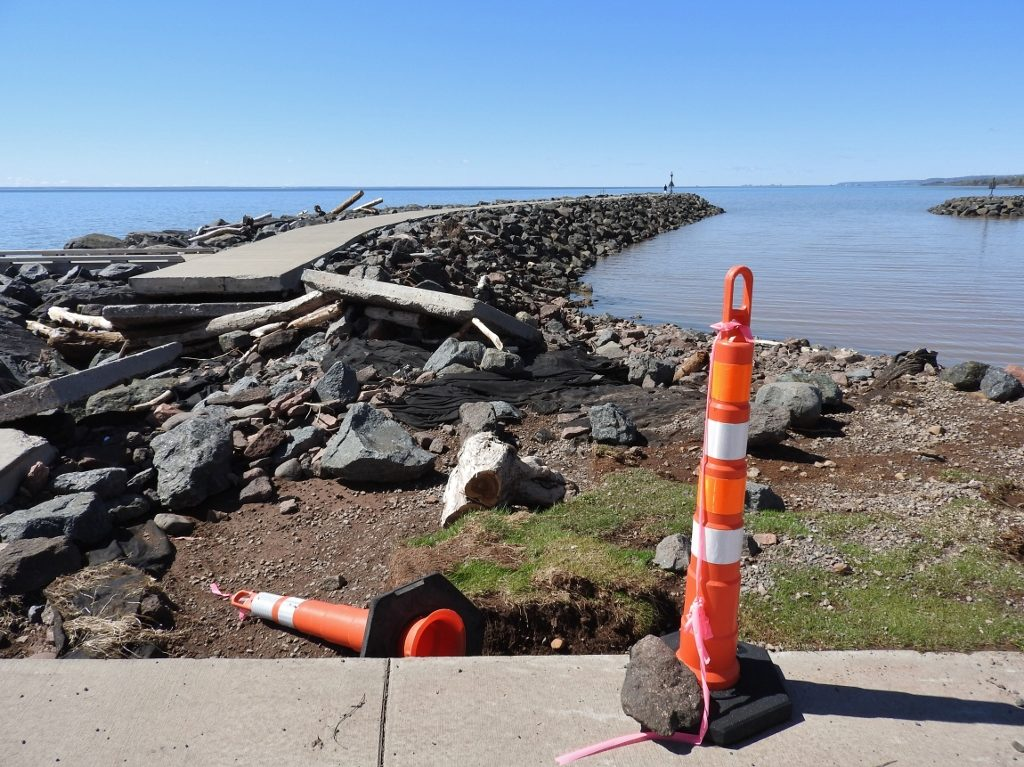 Powerful waves fueled by high water levels pushed around the walkway on top of the breakwall at McQuade Safe Harbor north of Duluth. EMILY STONE