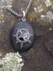 Basalt pendant with sun design in the Tinn Trad tradition, by Brad Nelson.